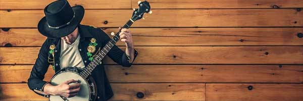 What Everyone Should Know about the History of Country Music banjo player - What Everyone Should Know about the History of Country Music